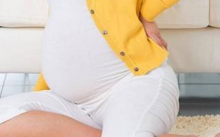 Почему болит поясница при беременности