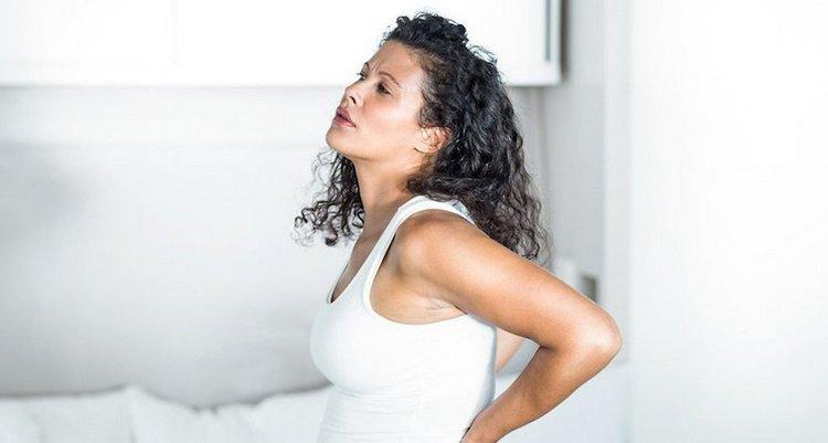 Нередко женщин в положении беспокоят тянущие боли в спине.