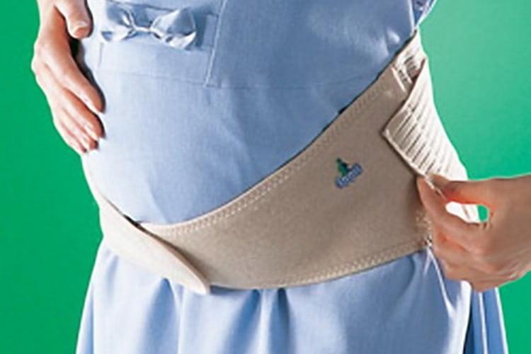Хорошо помогает поддерживающий корсет для беременных для спины, который значительно снижает нагрузку.